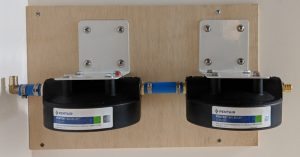Filter housings mounted to wall
